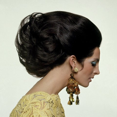 ca. February 15, 1967, New York City, New York, USA --- Yellow lace dress by Gustave Tassell; earrings by Robert Originals. --- Image by © Condé Nast Archive/Corbis